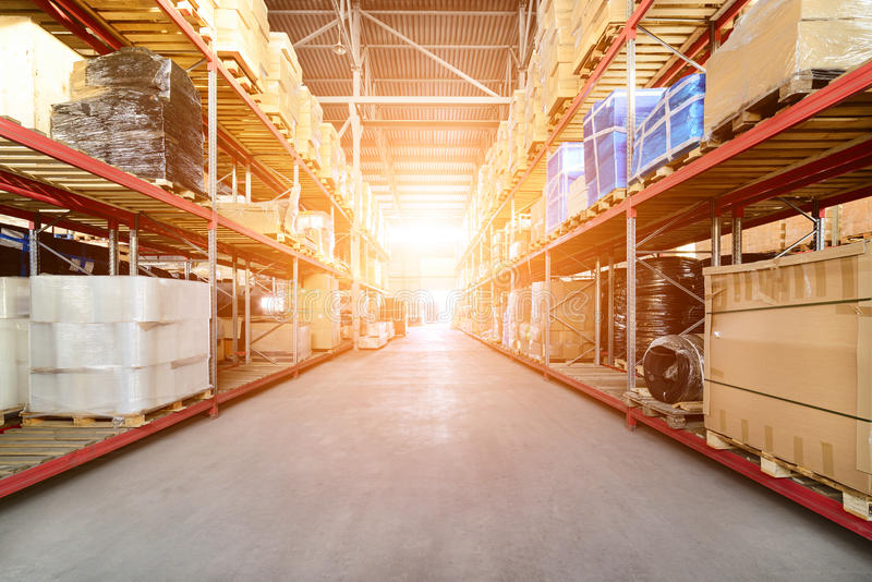 Long shelves with a variety of boxes and containers. royalty free stock photography
