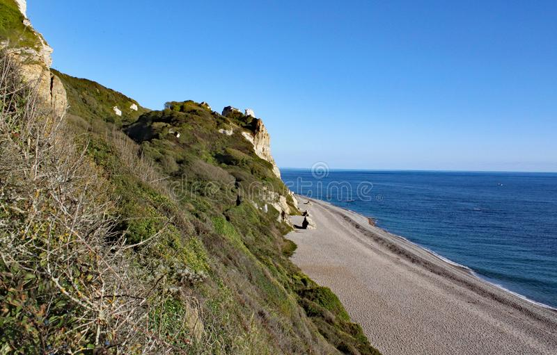 The long shingle beach at Brancombe in Devon, England. This is accessible by walking the coastal path stock photos