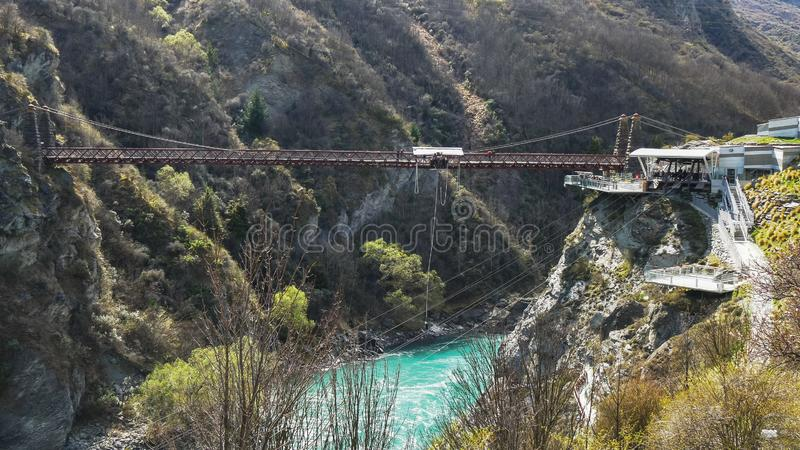 Long shot of the bungy jumping at kawarau bridge. A long shot of the bungy jumping at kawarau bridge in queenstown, new zealand royalty free stock image
