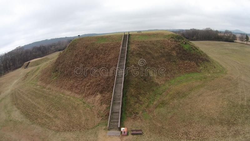 Long shot of Mound B of Etowah Indian Mounds Historic Site. Etowah Indian Mounds are prehistoric archaeological site located on the bank of Etowah river in the royalty free stock image