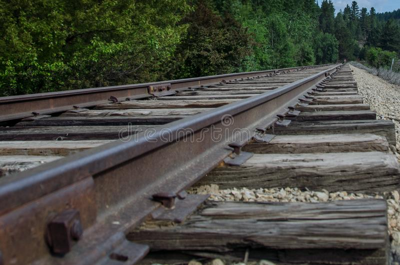 Long Silent Railroad Tracks Extending on and Waiting Patiently. Long Silent Railroad Tracks Extending onward and Waiting Patiently stock image