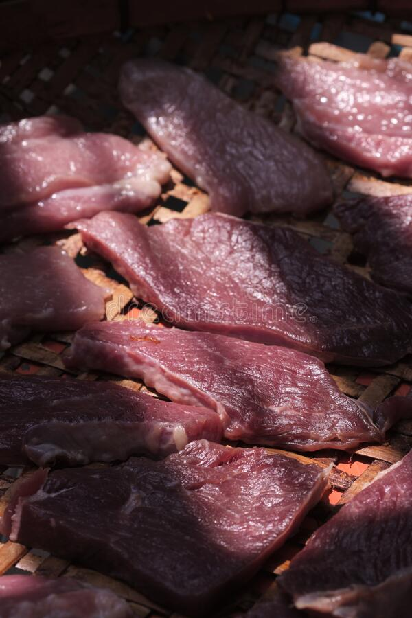 Long sliced of dried meat beef jerky dry. And selective focus royalty free stock photos