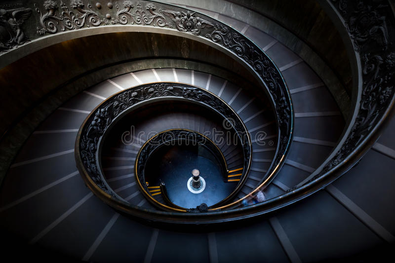 Long spiral, winding stairs. Dark shadows, soft light. stock photos