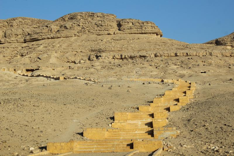 Long stairs in the mountain leading to old tombs royalty free stock photos
