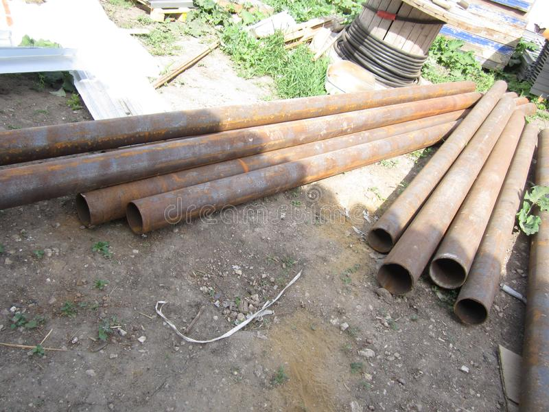 Long steel pipes on the ground stock images