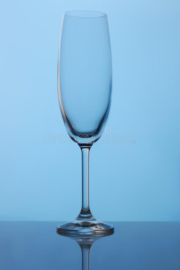 Long stem crystal champagne flutes. Blue lighting stock image