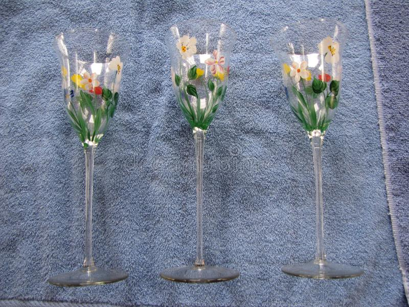 Long stemmed fancy with flower print glasses royalty free stock images
