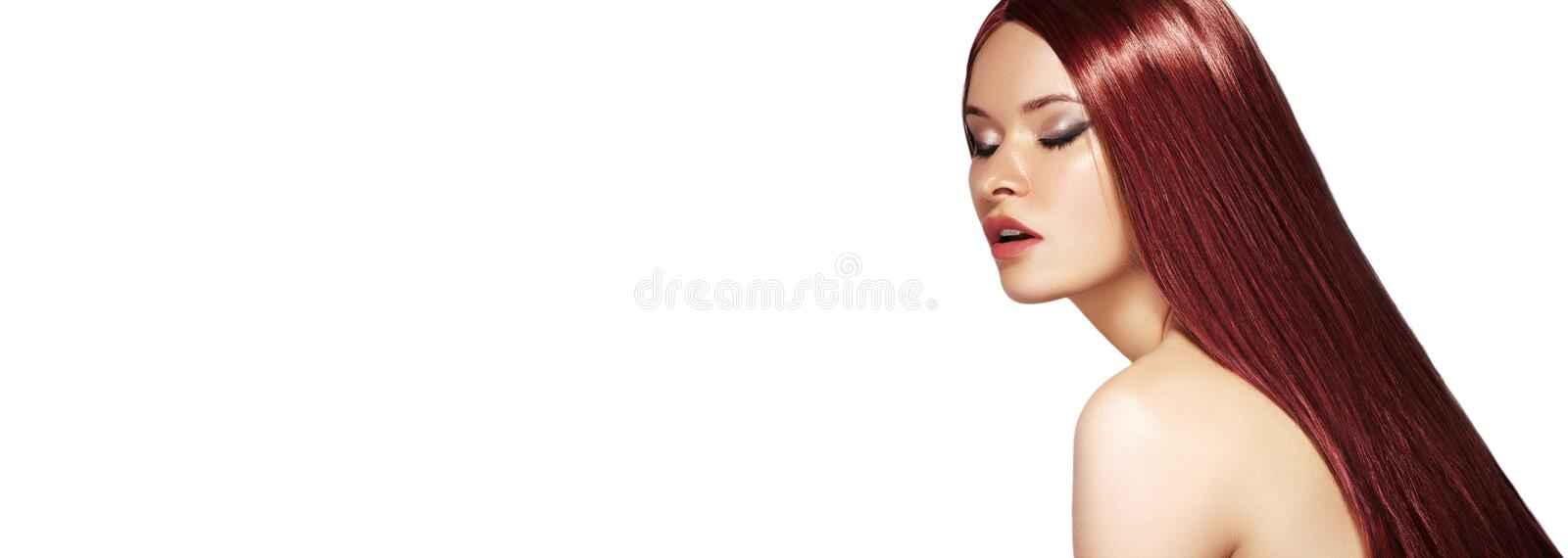 Long Straight Brown Hair. Fashion Model with Smooth red Hairstyle. Beauty with Makeup, keratin treatment. Copyspace stock images