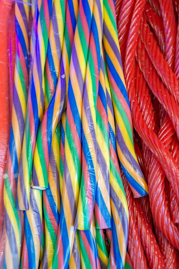 Long sweet coloured candies. Close view stock photography