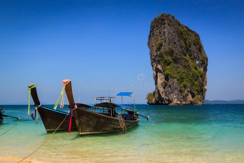 Long tail boat on the beautiful beach and beauty blue sky , poda island , krabi, Thailand.. royalty free stock photos