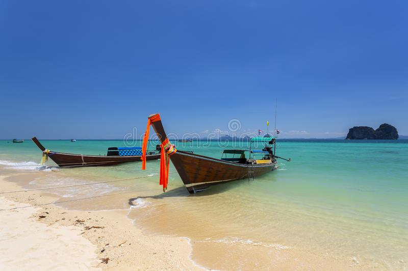 Long tail boat and beautiful beach at Koh Ngai island. On the southern andaman coast, Trang province, Thailand stock images