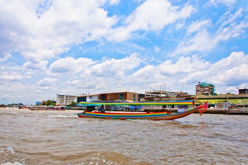 Long tail boat down Chao Praya river in Bangkok