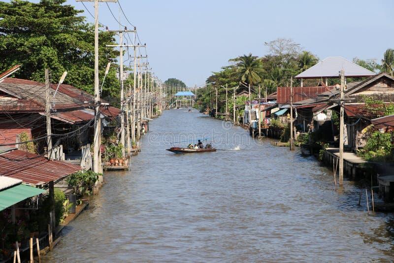 Long tail boat driving on the Damnoensaduak canal at Ratchaburi Thailand royalty free stock image