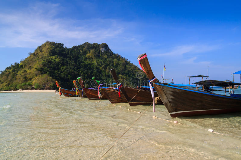 Long tail boat in front of twin sea island royalty free stock images