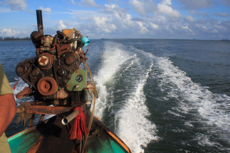 Long tail boat motor engine in tranquil sea royalty free stock photos