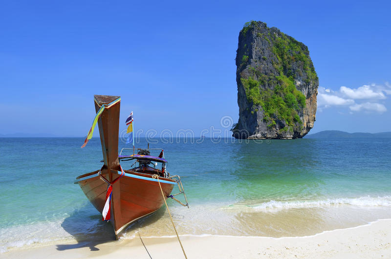 Long tail boat on Poda island beach with the famous Ko Ma Tang Ming rock stock images