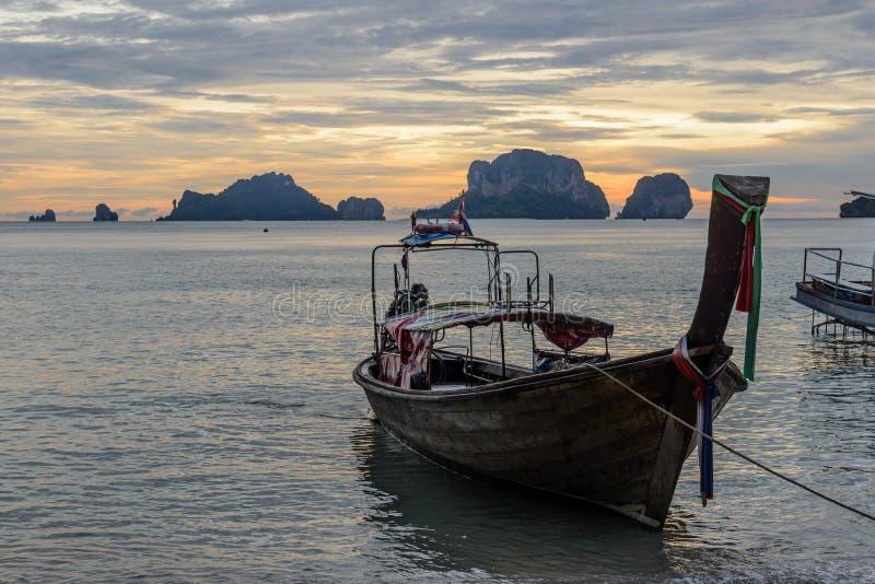Long tail boat at Sunset at Ko Rang Nok Island in Ao Phra Nang beach, Krabi. Long tail traditional boat at sunset twilight at Ko Rang Nok island in Phra Nang stock photos