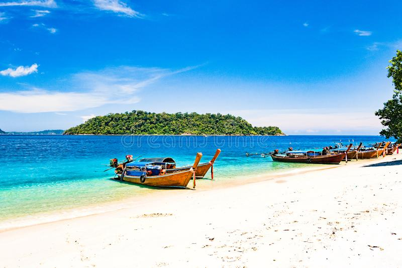 Long tail boat on tropical beach, Andaman Sea Thailand stock images