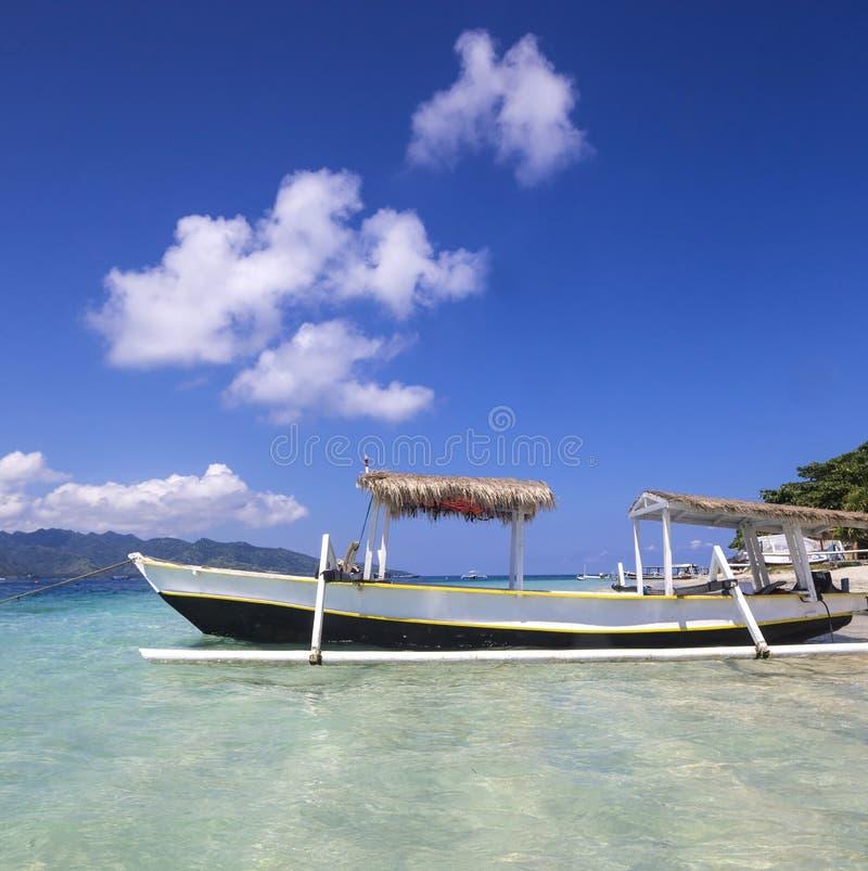 Long Tail Boat on Tropical Beach. Gili island, Bali stock photo