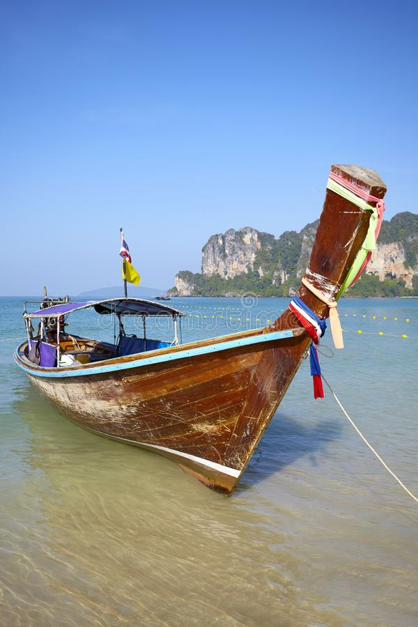Long tail boat at a tropical beach, Thailand royalty free stock images