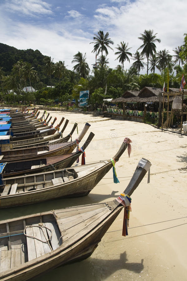 Long Tail Boats Along Beach Stock Images
