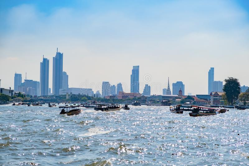 Long-tail boats in Chao Phraya river in Bangkok, Thailand. Tourist And Thai People Traveling By Boat. Image with selective focus stock image