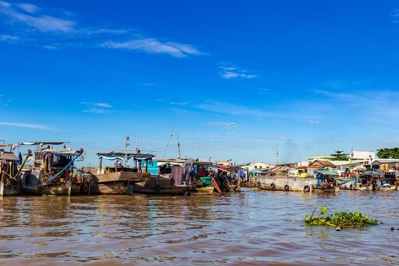 Long-tail boats, house boats and sampans moored side by side in Mekong Delta, Vietnam. Long-tail boats, house boats and sampans with laundry drying moored side royalty free stock images