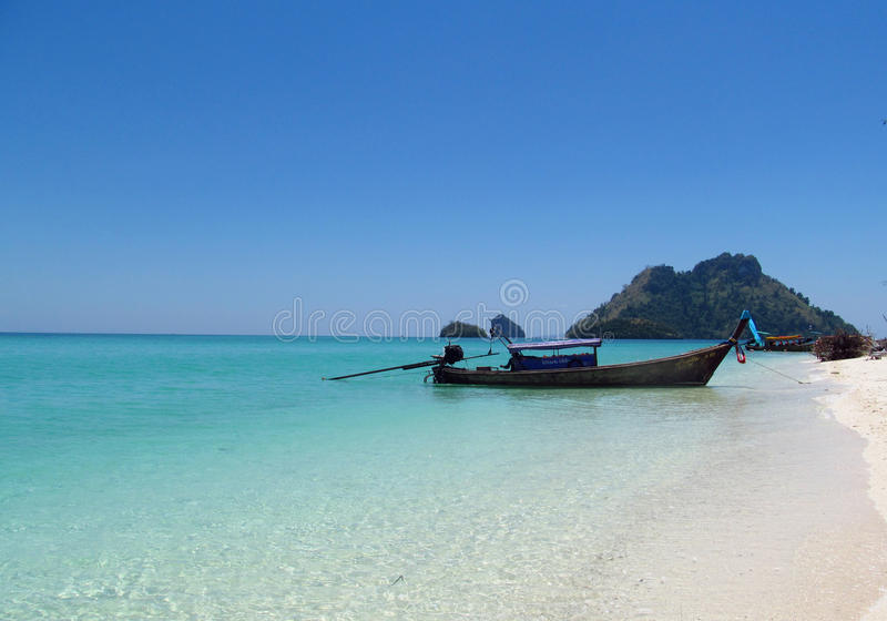 Long tail boats in Krabi Beaches and Islands Thailand. Krabi Beaches and Islands Thailand, limestone rock formations. Beautiful white sand beach, palm trees royalty free stock photos