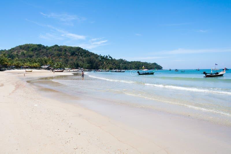 Long tail boats on the south end of Bang Tao beach, Phuket, Thailand.  stock photos
