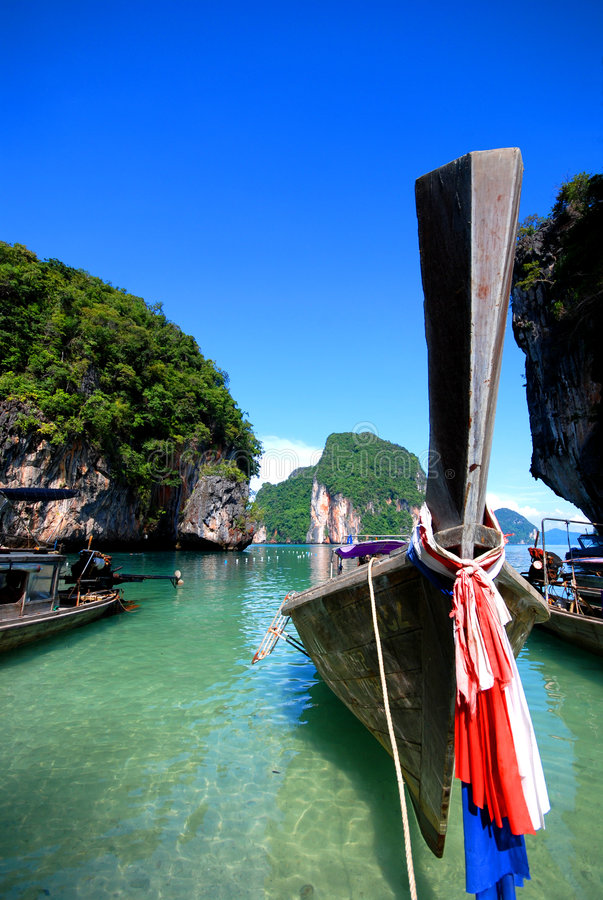 Long tail boats in Thailand stock images