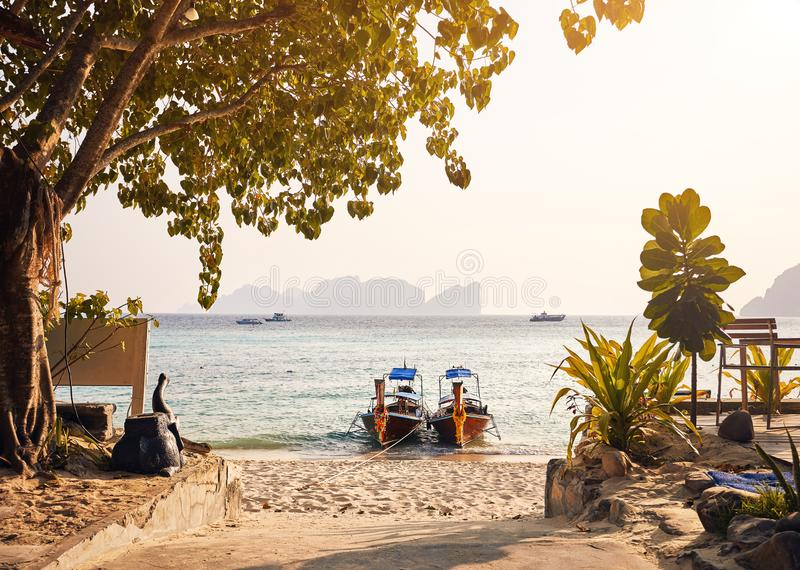 Long tail boats on tropical beach stock image