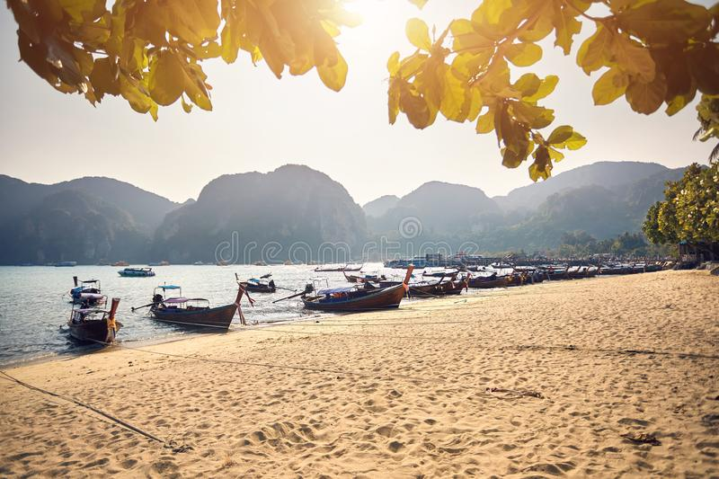 Long tail boats on tropical beach royalty free stock photography