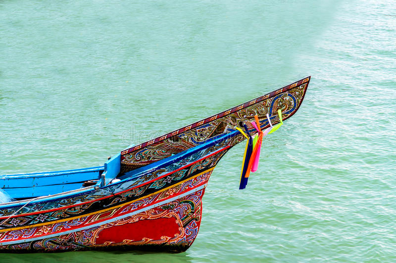 Long-tailed boat at the beach and blue sky in thailand stock images