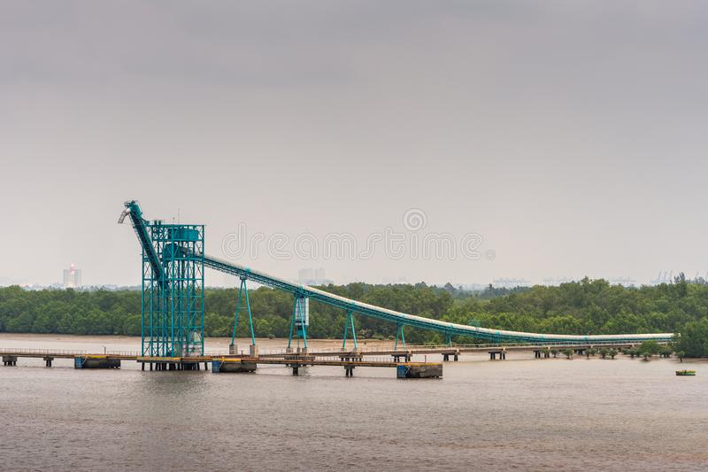 Dock and pipeline system at Phuoc Khanh petroleum port along Long Tau River, Vietnam stock images