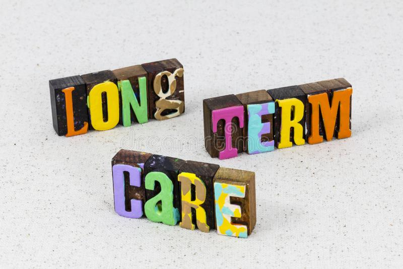 Long term care nursing home elderly caregiver healthcare. Long term elderly medical and senior care nursing home is elder caregiver wellness.  Disability patient stock photo