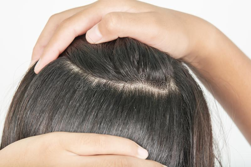 Long and thick hair of women. And hands show stock image