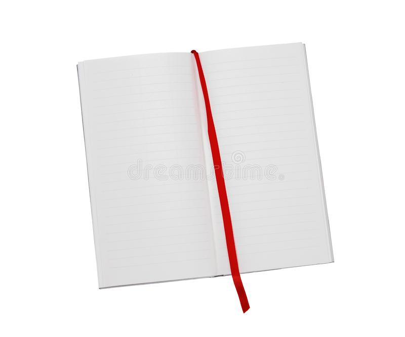 Long, thin, lined notebook background with red fabric bookmark. New page, new leaf concept. Isolated on white background stock photography