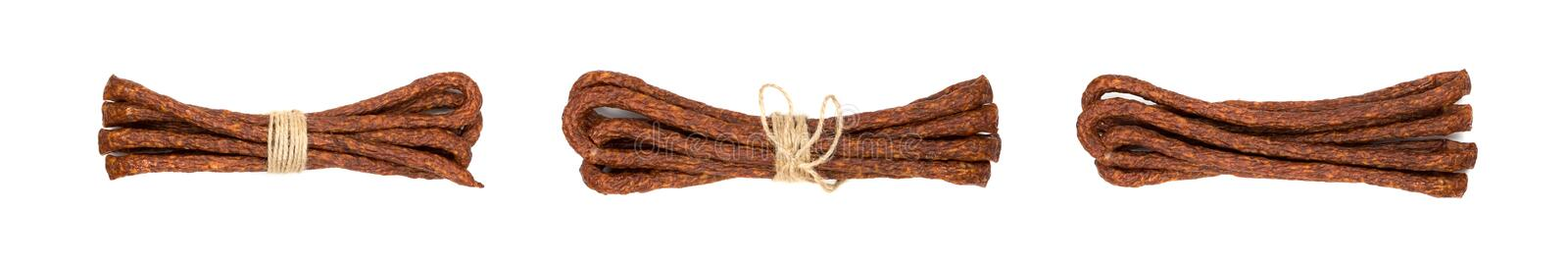 Long thin smoked sausages tied with string isolated on white stock photography