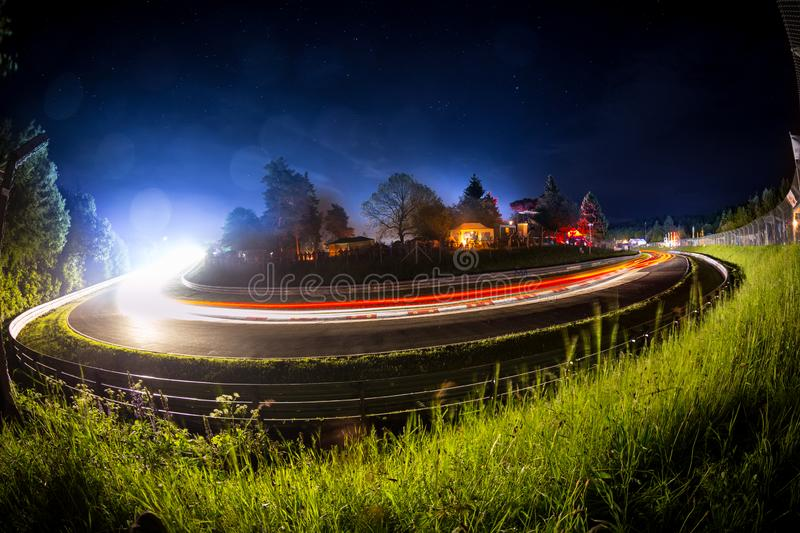 Long time exposure bulb shot of an 24h car race during night motorsport background stock image
