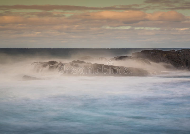 Long time exposure of waves around rocks at the Wild Coast at th. E Indian Ocean in South Africa during summertime royalty free stock image