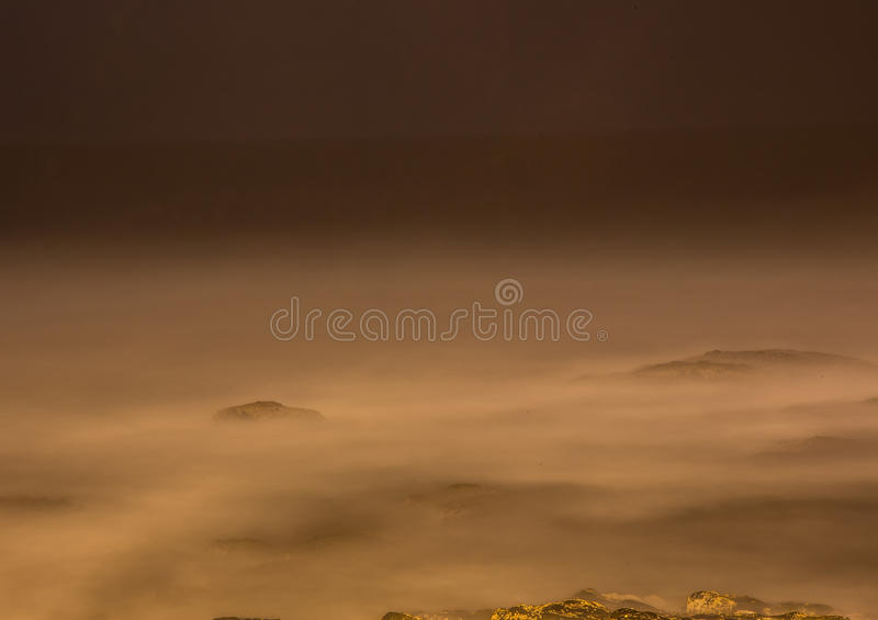 Long time exposure of waves around rocks at the Wild Coast at th. E Indian Ocean in South Africa during summertime stock images