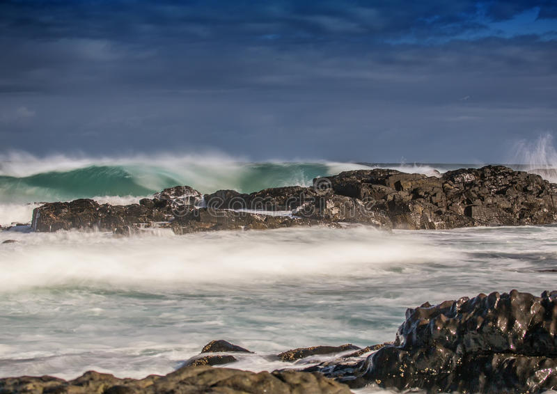 Long time exposure of waves around rocks at the Wild Coast at th. E Indian Ocean in South Africa during summertime royalty free stock photography