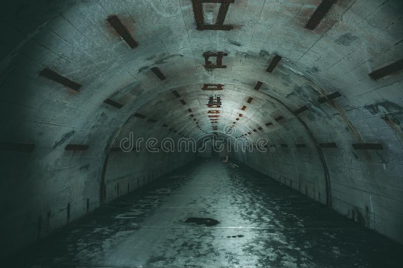 Long underground tunnel or corridor in abandoned Soviet military bunker or basement royalty free stock images