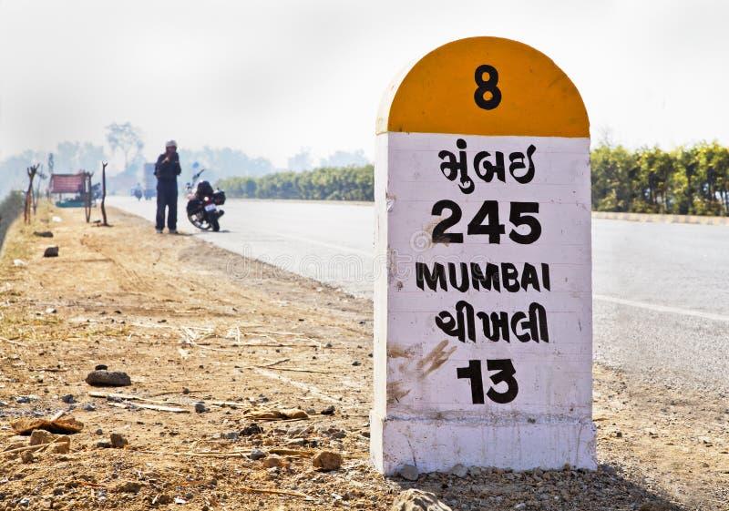 Download Long way to Mumbai stock photo. Image of kilometres, clock - 24130908