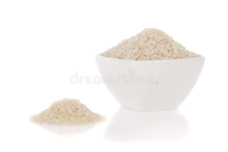 Long white rice in a bowl isolated on white stock photography