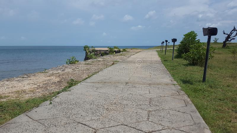 Long path by the beach. A long winding promenade at the KKS beach, in Jaffna royalty free stock image