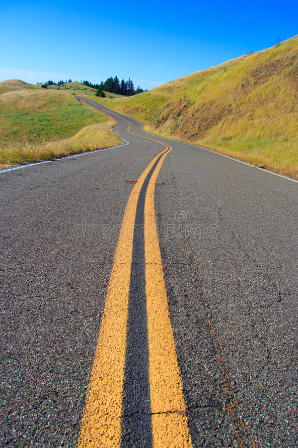 The long and windy road. Photographed on one of the most widely used roads in America for car commercials. Ridgecrest Drive, or as it's more affectionately royalty free stock photos