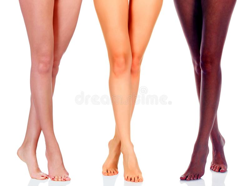 Long woman legs of black and caucasian girls royalty free stock photo
