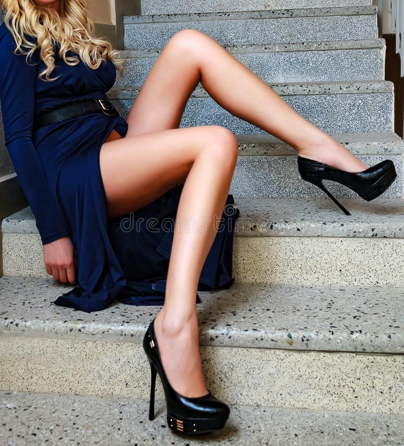 Woman`s legs on a stairs royalty free stock photo