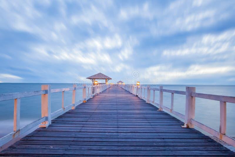 Long wood bridge at sea. In sunset time stock photo